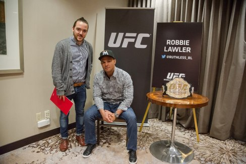 Tom with UFC welterweight champion Robbie Lawler at an official press event.